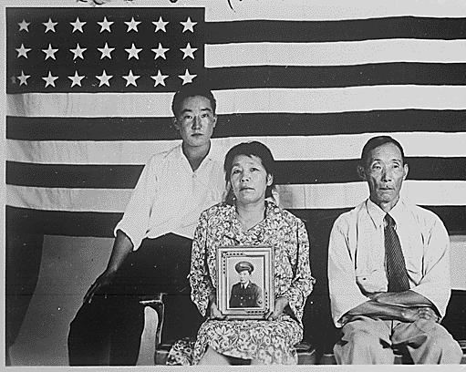The Hirano family, left to right, George, Hisa, and Yasbei. Colorado River Relocation Center, Poston, Arizona., 1942 - 1945